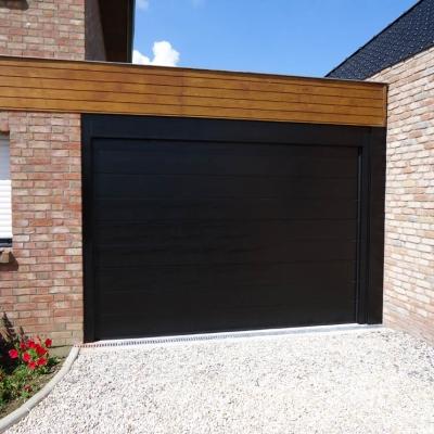 Porte sectionnelle monorainure coloris noir